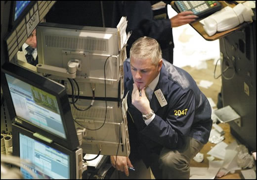 A Floor Trader checking market prices (Floor trader at the New York Stock Exchange)